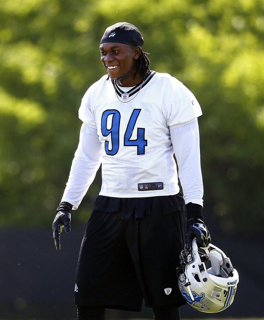 Detroit Lions defensive end Ezekiel Ansah watches during NFL football practice in Allen Park, Mich., Thursday, June 2, 2016. (AP Photo/Paul Sancya)