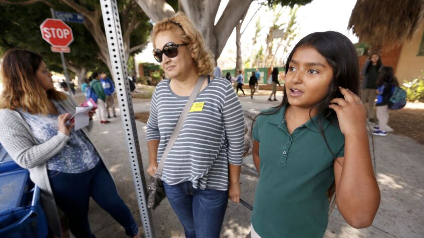 Webster Middle School sixth-grader Julieann Gonzalez, 11, right, with her mother, Angela Rodriguez,