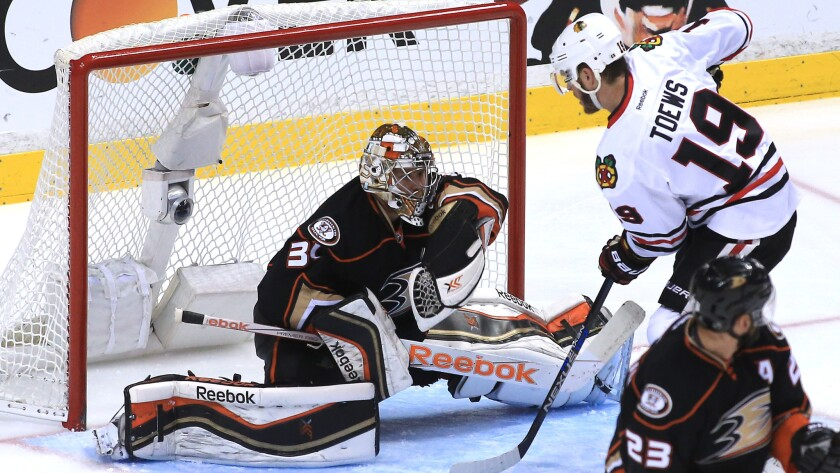 Ducks goalie Frederik Andersen makes a save on a shot by Chicago Blackhawks captain Jonathan Toews during the third period of Game 2 of the Western Conference finals at Honda Center on May 19, 2015.