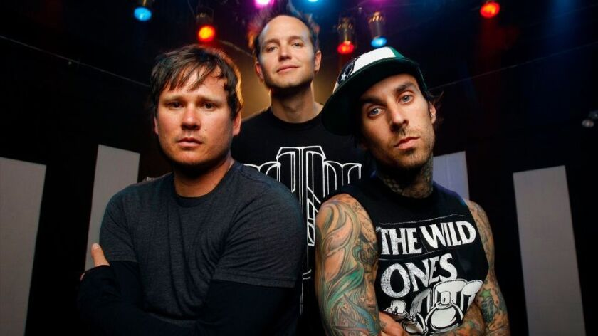 Blink-182 are shown at their first reunion performance in 2009. From left, Tom DeLonge, Mark Hoppus and Travis Barker. DeLonge is not currently in the band.