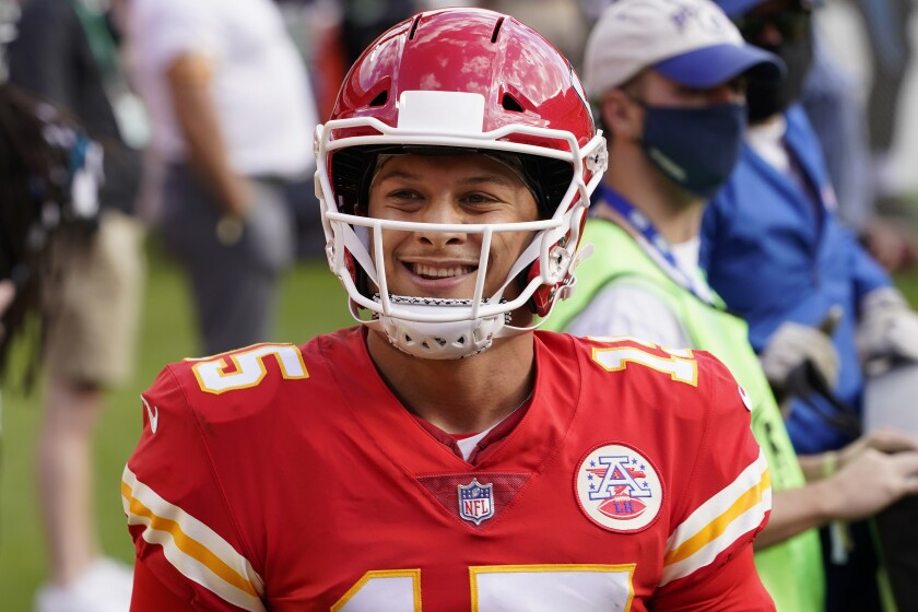 Kansas City Chiefs quarterback Patrick Mahomes (15) smiles during the second half of an NFL football game against the Carolina Panthers in Kansas City, Mo., Sunday, Nov. 8, 2020. (AP Photo/Orlin Wagner)