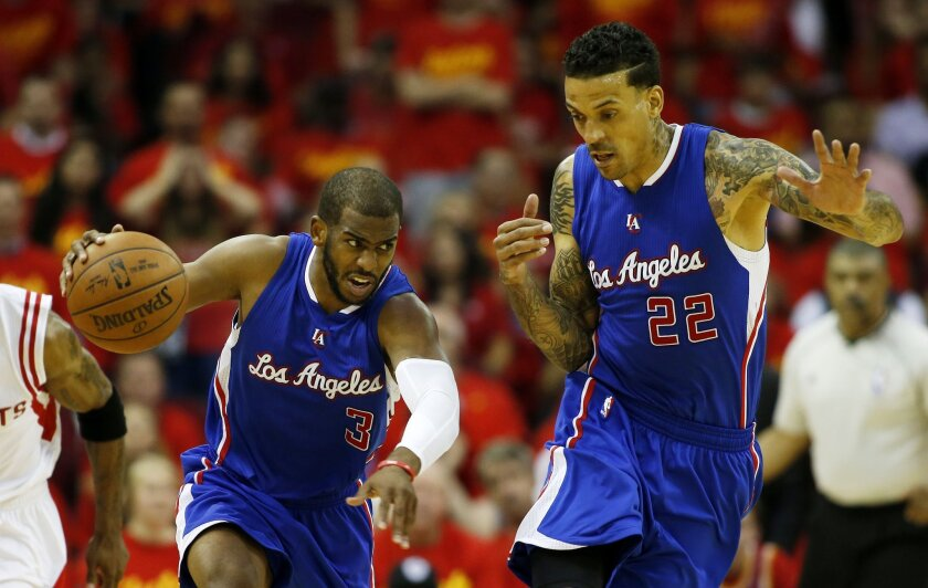 Chris Paul controls the ball as Clippers teammate Matt Barnes backs out of the way.