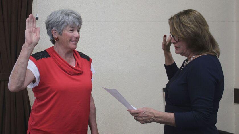 New La Jolla Town Council trustee Gale Forbes (left) is sworn in by president Ann Kerr Bache.