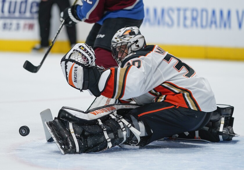 Ducks goaltender Ryan Miller makes a save against the Avalanche during the third period Saturday night.