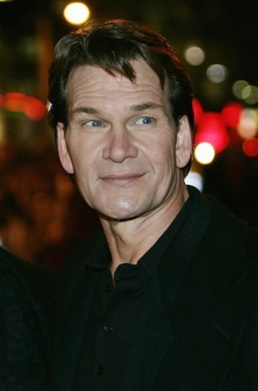 """In this Nov. 28, 2005 file photo, actor Patrick Swayze poses for the photographers, prior to the premiere of his new film """"Keeping Mum"""" at a Leicester Square cinema in central London. (AP Photo/Lefteris Pitarakis, file)"""