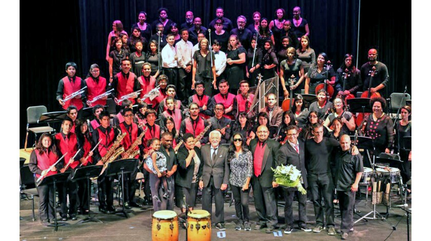 Victor de los Santos, front and center in red vest, poses with his Santa Ana High School band.