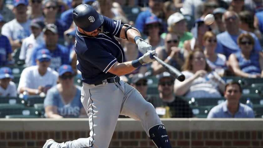Austin Hedges hits a home run against the Chicago Cubs on Saturday.