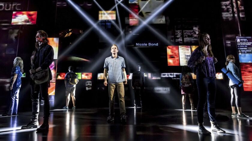 "This image released by O&M/DKC shows Ben Platt, center, during a performance of ""Dear Evan Hansen."""