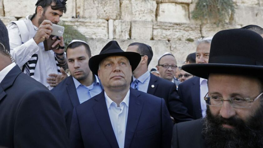 """Hungarian Prime Minister Viktor Orban, center, visits the Western Wall in Jerusalem on July 20. Orban pledged """"zero tolerance"""" for anti-Semitism after being accused of stoking anti-Jewish sentiment at home."""