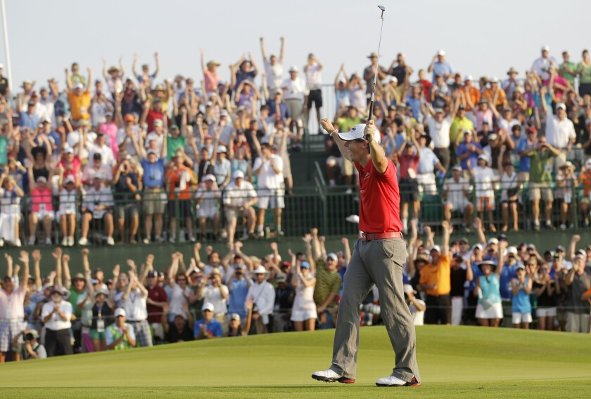 FILE - Rory McIlroy of Northern Ireland reacts to his victory on the 18th green in the final round of the PGA Championship golf tournament on the Ocean Course of the Kiawah Island Golf Resort in Kiawah Island, S.C., in this Sunday, Aug. 12, 2012, file photo. The PGA is limiting attendance at Kiawah this year to 10,000 fans a day. (AP Photo/John Raoux, File)
