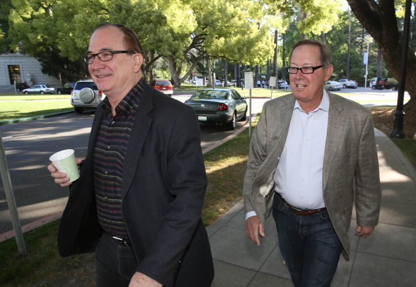 Robert Huff (R-Diamond Bar), left, and Sen. Tom Berryhill (R-Modesto) walk to a recent ethics training session. The two are among 11 Republican senators who proposed new ethics rules Wednesday.