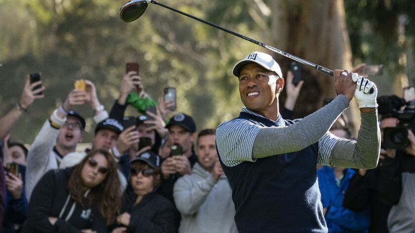PACIFIC PALISADES, CA - FEBRUARY 16, 2019: Tiger Woods watches his tee shot on the 11th hole during