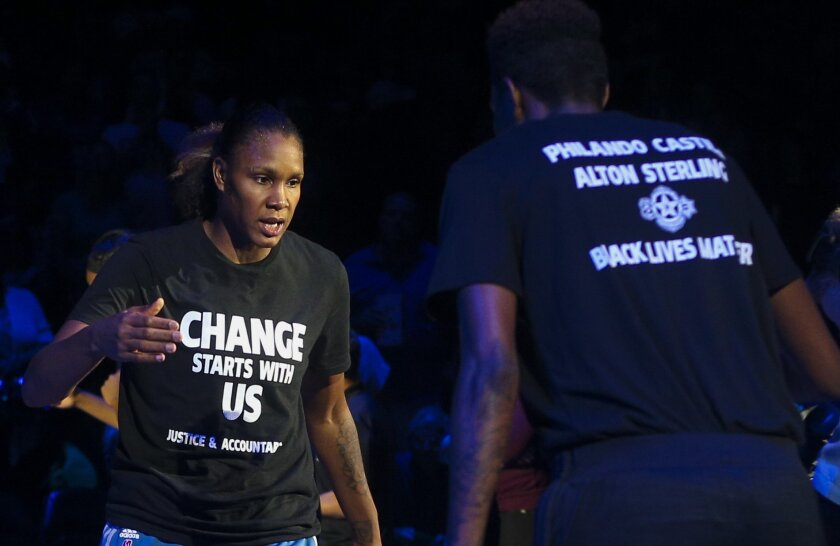 FILE - In this July 9, 2016, file photo, Minnesota Lynx forward Rebekkah Brunson, left, is greeted by Minnesota Lynx forward Natasha Howard while starting lineups are announced at the Target Center in Minneapolis. The Lynx have heard it all since they donned black t-shirts before a game in remembrance of two men who were shot by police and the five Dallas police officers who were killed in an attack last week. They have been hailed as crusaders for using their platform to start a dialogue about the issue of police violence and also told they should just shut up and play ball. (Timothy Nwachukwu/Star Tribune via AP, File)