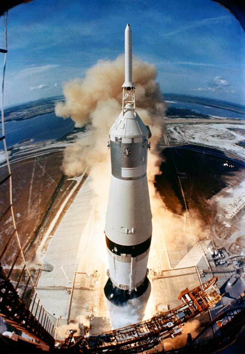 The Saturn V rocket carrying Apollo 11 launches from Kennedy Space Center in Florida at 9:32 a.m. on July 16, 1969.