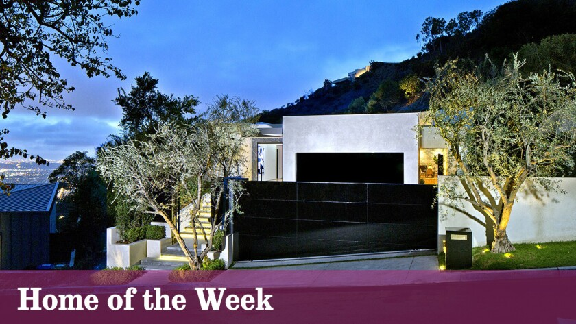 The remodeled contemporary at 1877 Rising Glen Road, Los Angeles, is listed at $18.95 million.