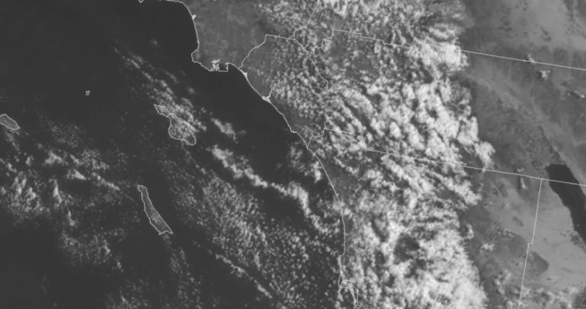 Fresh rain and light snow will move into San Diego County late Tuesday night
