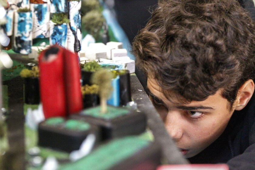 Marlo Irani, 14, from the Wildwood School in Los Angeles, works on the vacuum system of his team's city named Fortune Lake during the Future City Competition at The Rhoades School in Encinitas.
