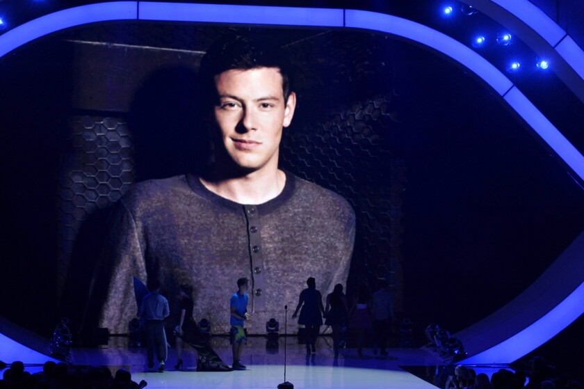 Cory Monteith is pictured on screen at the Teen Choice Awards in August as a tribute to the late actor.