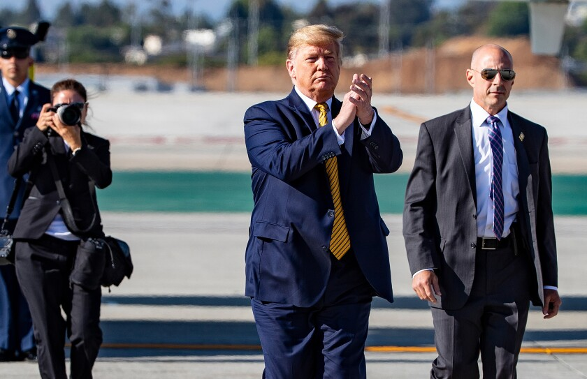 President Trump arrives at Los Angeles International Airport on Tuesday.