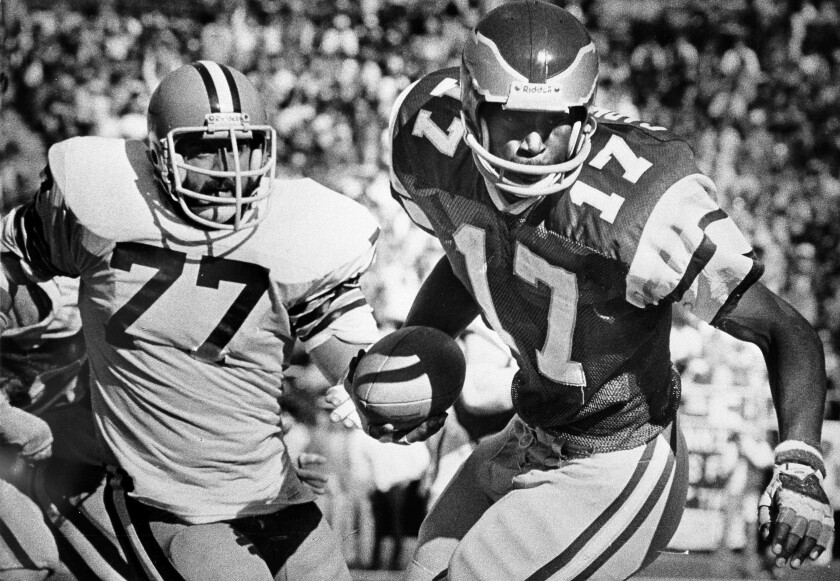 FILE - In this Nov. 4, 1979, file photo, Philadelphia Eagles' Harold Carmichael (17) pulls away from Cleveland Browns' Lyle Alzado (77) after catching a pass during the first half of an NFL football game in Philadelphia. Carmichael used his size to outjump and overpower defenders, catching more passes for more yards and touchdowns than any player in the history of the Philadelphia Eagles. The gentle giant then waited patiently for three decades before he was elected to the Pro Football Hall of Fame as part of last year's special centennial class.(AP Photo/Gene Puskar, File)