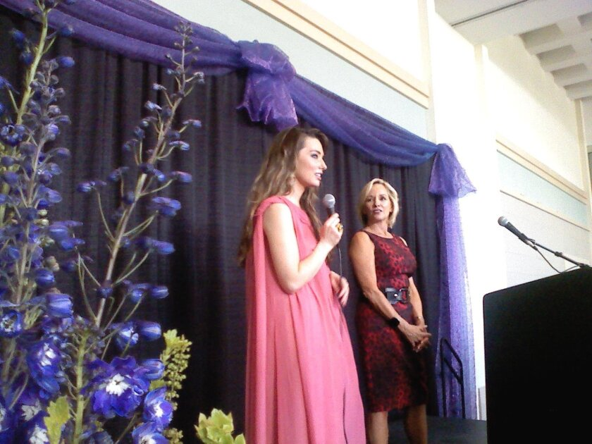 Fashion designer Lauren Elaine is interviewed by Andrea Naversen, editor-at-large of Ranch & Coast Magazine, after Friday's charity fashion show at San Diego Women's Week.