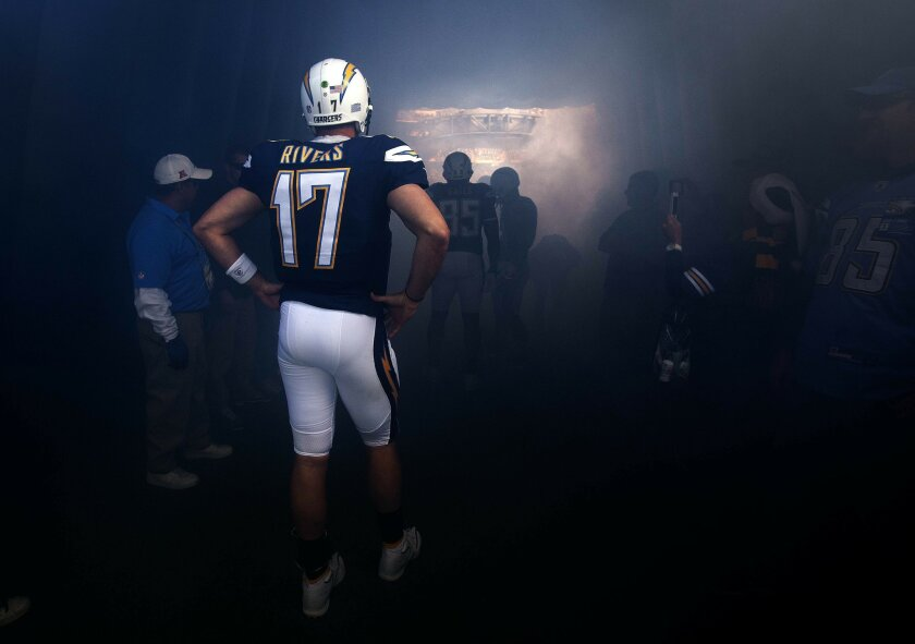 The San Diego Chargers vs. The New York Giants at Qualcomm Stadium. Philip Rivers waits in the inflatable helmet prior to taking the field.