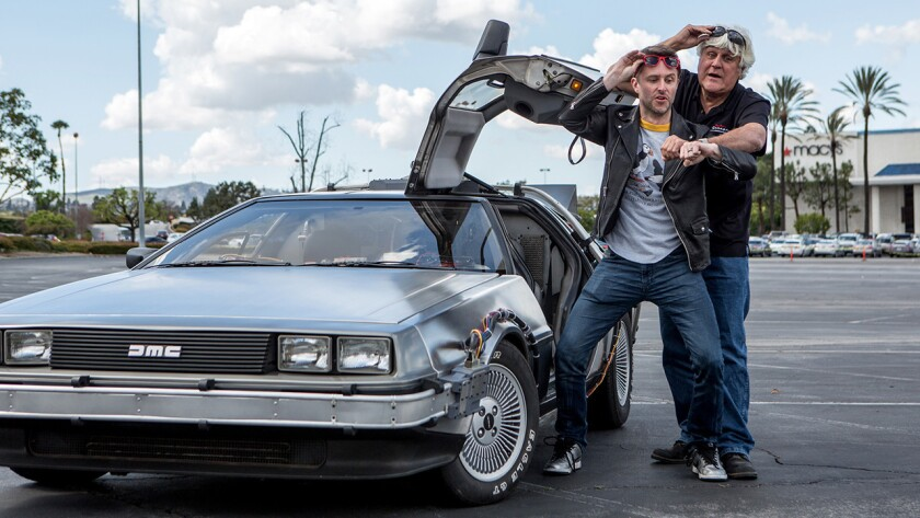 """Chris Hardwick, left, and Jay Leno with the """"Back to the Future"""" DeLorean, in a new episode of """"Jay Leno's Garage"""" on CNBC."""