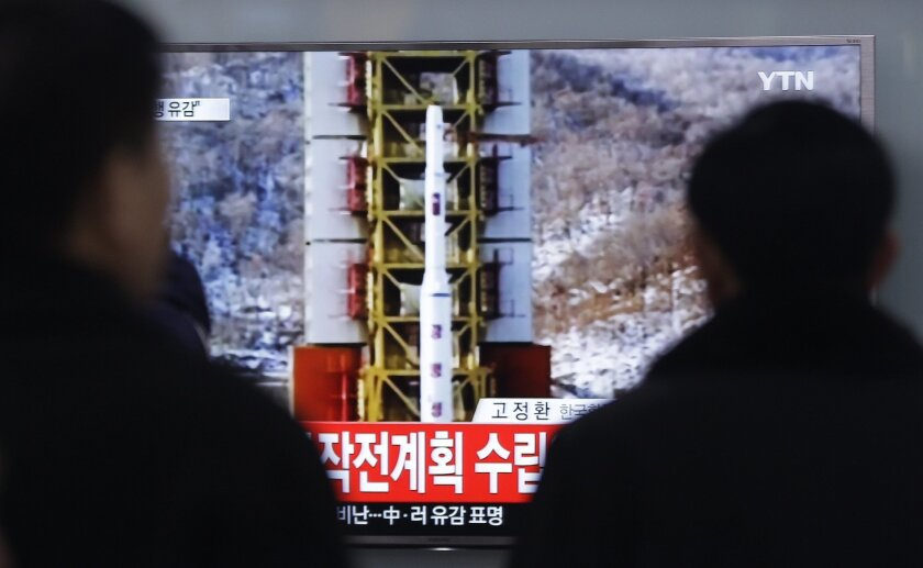 """People watch a TV news reporting a rocket launch in North Korea, at Seoul Railway Station in Seoul, Sunday, Feb. 7, 2016. For North Korea's propaganda machine, the long-range rocket launch Sunday carved a glorious trail of """"fascinating vapor"""" through the clear blue sky. For South Korea's president,"""