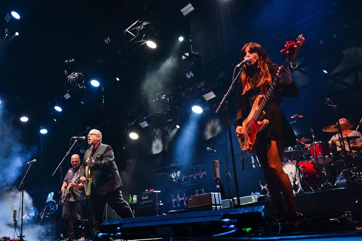 Pixies lead singer Frank Black (center) and bassist Paz Lenchantin. (Patricia De Melo Moreira/AFP/Getty Images)