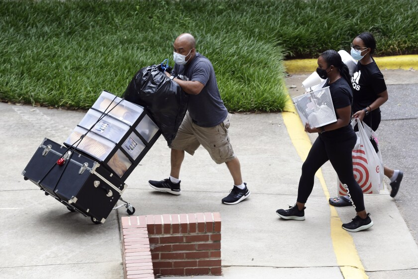 Students move in for fall semester at North Carolina State University in Raleigh.