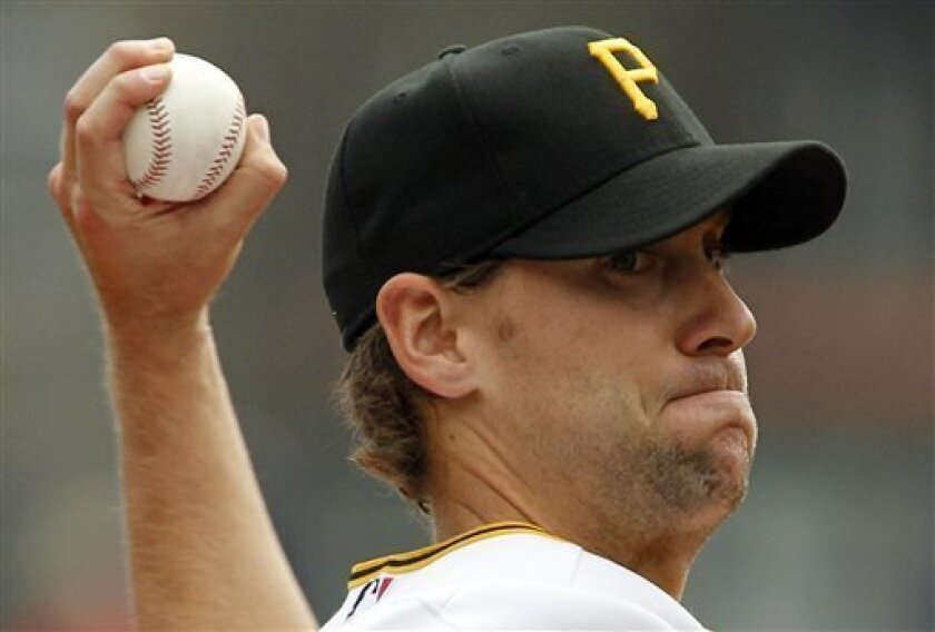 Pittsburgh Pirates pitcher Brian Burres throws against the Atlanta Braves in the first inning of a baseball game in Pittsburgh Monday, Sept. 6, 2010. (AP Photo/Gene J. Puskar)