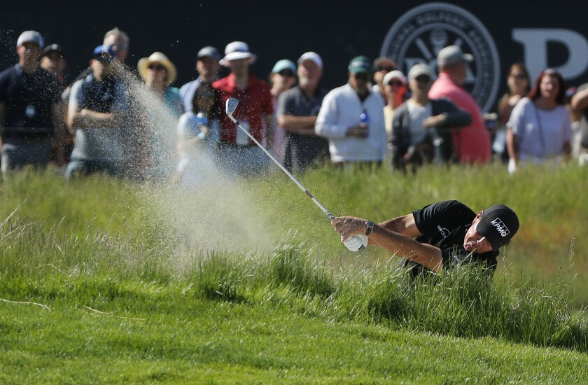 Phil Mickelson hits out of a bunker on the 17th hole during the third round of the PGA Championship, Saturday, May 18, 2019, at Bethpage Black in Farmingdale, N.Y.