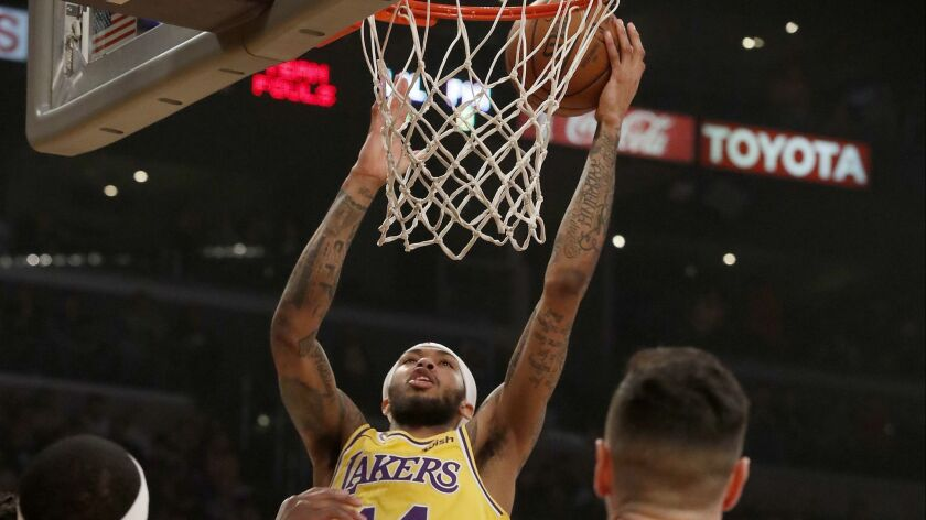 LOS ANGELES, CALIF. - JAN. 29, 2019. Lakers forward Brandon Ingram scores a basket against the Sixe