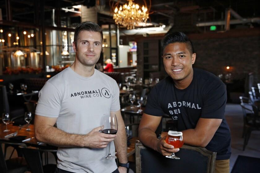 Abnormal Brewing Winemaker Matt DeLoach (left) and Brewmaster Derek Gallanosa at Cork & Craft in Rancho Bernardo. (Nancee E. Lewis)