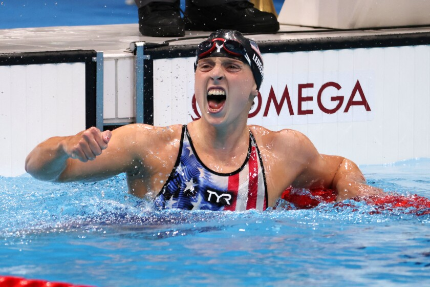 Katie Ledecky celebrates after winning the women's 1,500-meter freestyle.