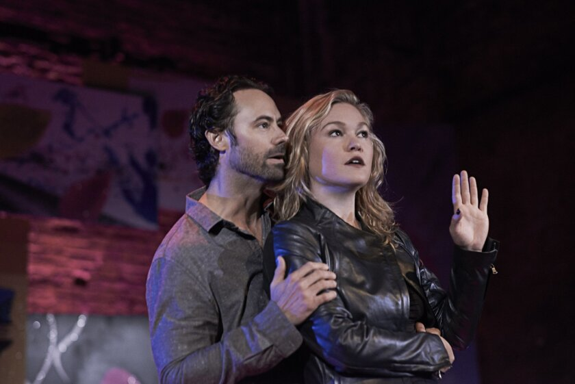 """This image released by Polk & Co. shows Julia Stiles, right, and James Wirt in a scene from """"PHOENIX"""" in New York. Presented by Nicholas Jabbour, """"PHOENIX"""" will play a limited engagement through Saturday, Aug. 23, 2014. (AP Photo/ Polk & Co., Harry Fellows)"""