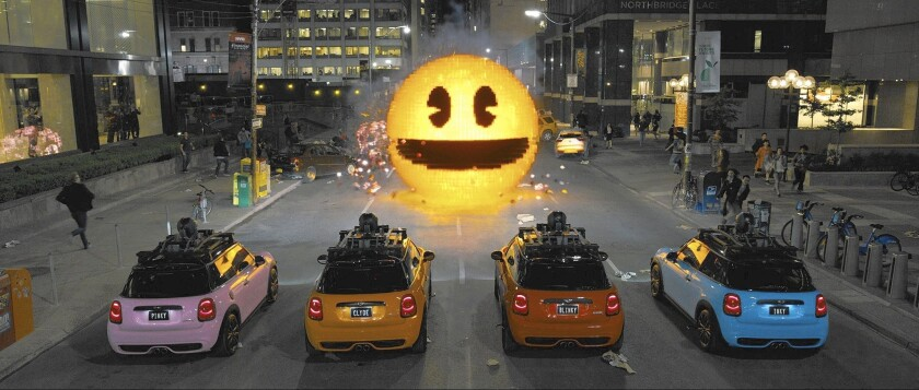 """A Pac-Man chomping its way through New York is among the outer-space video-game invaders in """"Pixels."""""""