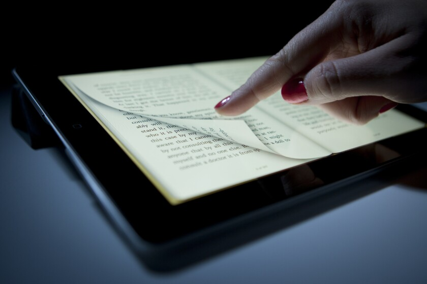 Reading an e-book on Apple's iPad.