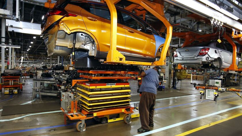 A battery is lifted into place for installation in the Chevrolet Bolt EV at the General Motors Orion