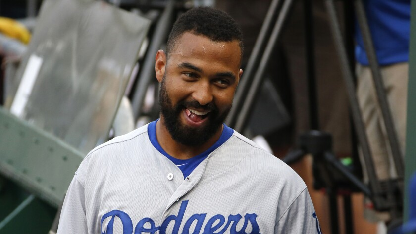 Dodgers right fielder Matt Kemp smiles in the dugout before the team's 5-2 victory over the host Pittsburgh Pirates on Monday.