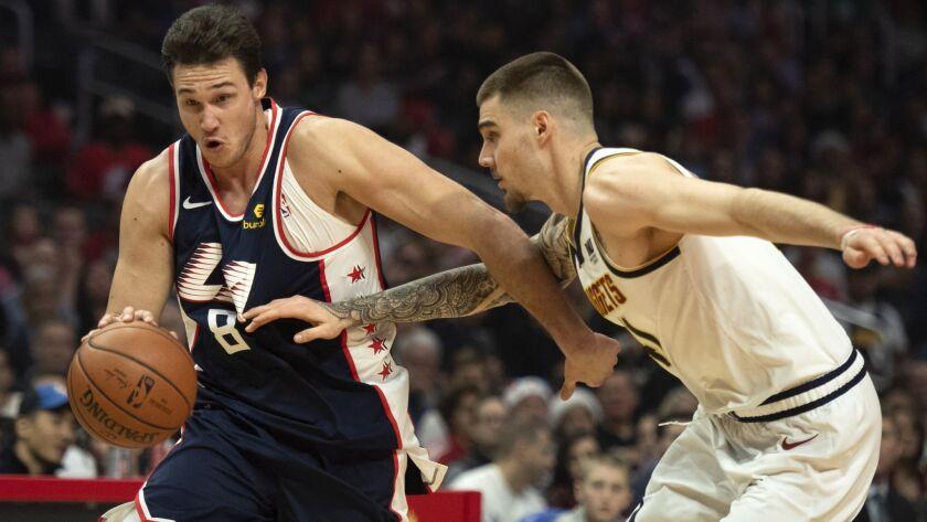 Los Angeles Clippers forward Danilo Gallinari, left, drives toward the basket past Denver Nuggets fo
