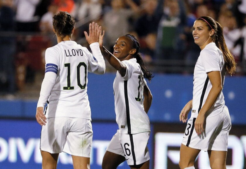 United States' Carli Lloyd (10) congratulates Crystal Dunn (16) on her goal against Costa Rica as Alex Morgan, right, watches during the first half of a CONCACAF Olympic qualifying tournament soccer match Wednesday, Feb. 10, 2016, in Frisco, Texas. (AP Photo/Tony Gutierrez)