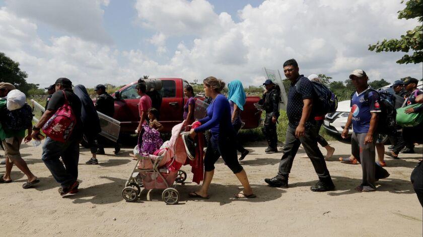 Migrant caravan crosses Suchiate river between Guatemala and Mexico, Ciudad Hidalgo - 29 Oct 2018