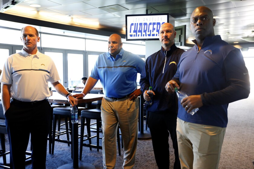 Chargers Coach Anthony Lynn, from right, stands with new additions to the team, including defensive coordinator Gus Bradley, special team coordinator-assistant coach George Stewart and offensive coordinator Ken Whisenhunt, before being introduced to the media on Feb. 21.