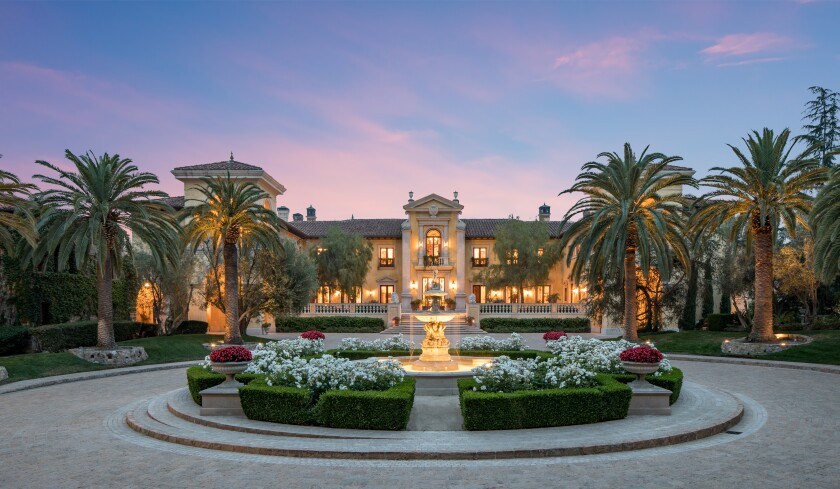 The estate centers on an Italian-inspired mansion.