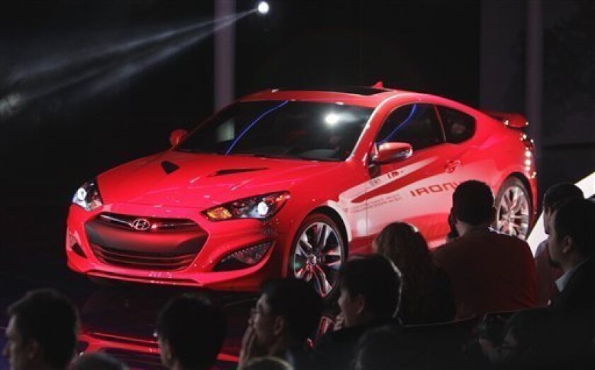 The Hyundai Genesis Coupe is unveiled at the North American International Auto Show in Detroit, Monday, Jan. 9, 2012. (AP Photo/Carlos Osorio)