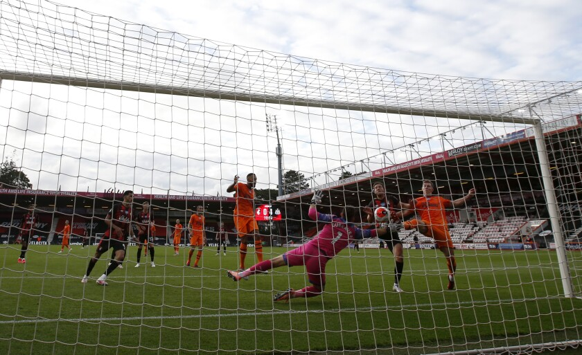 Bournemouth's Dan Gosling, second right, scores his side's opening goal during the English Premier League soccer match between Bournemouth and Newcastle at Vitality Stadium in Bournemouth, England, Wednesday, July 1, 2020. (Peter Cziborra/Pool via AP)