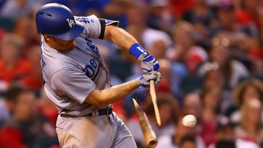 ST. LOUIS, MO - MAY 30: Logan Forsythe #11 of the Los Angeles Dodgers breaks his bat but knocks in a