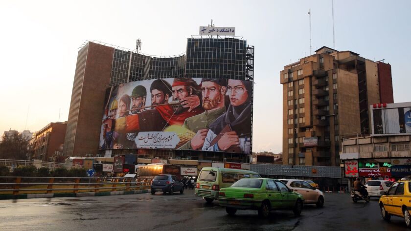 Iranians drive past Vali-Asr square Jan. 7 in Tehran. Media reported that after several days of anti-regime protests, the situation on the streets is back to normal.