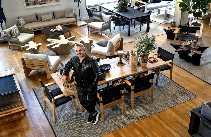 Interior designer Martyn Lawrence Bullard at Harbour Outdoor in Los Angeles. The dining chairs are shown in natural teak finish with olefin Copacabana midnight fabric and the table is shown in natural teak finish and brass accents.